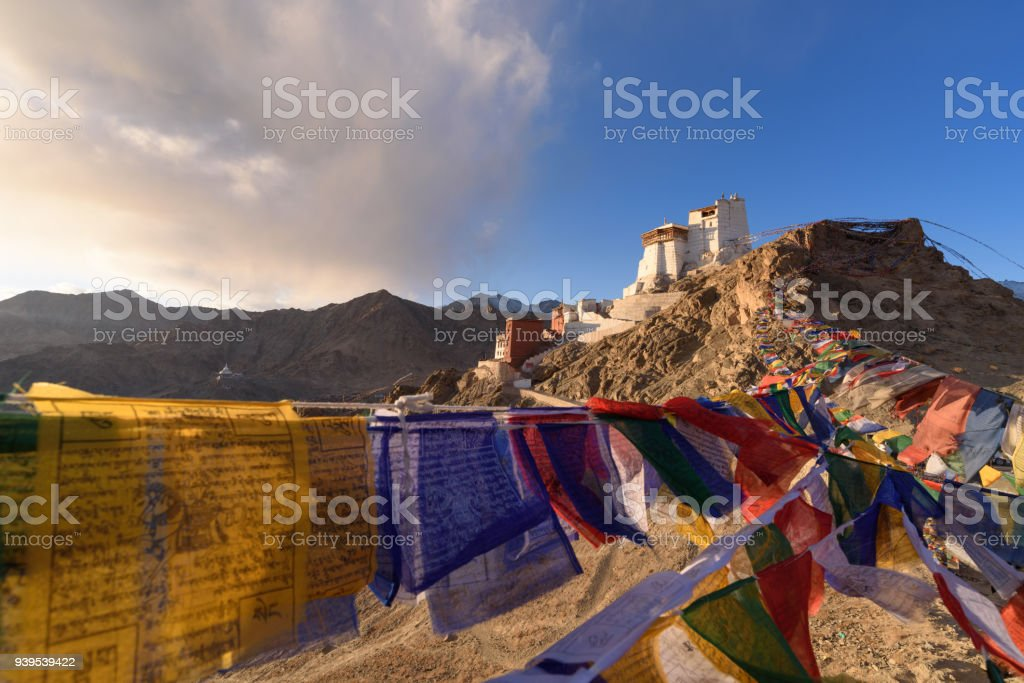 monastery on the hill with mantra flag,beautiful sunset time in leh ladakh famous travel destination in India stock photo