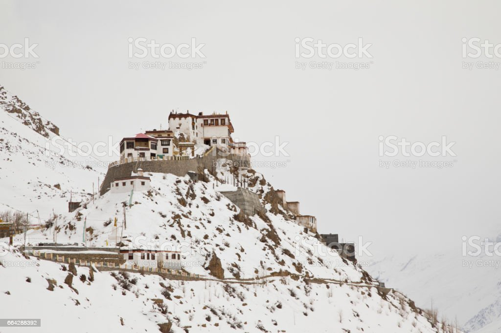 Monastery on top of snowcapped Himalayan mountain stock photo