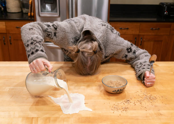 Monday Morning A Woman Having a Rough Day with Breakfast stock photo