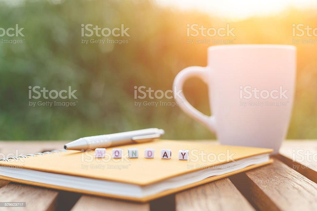 Monday written in letter beads and a coffee cup stock photo