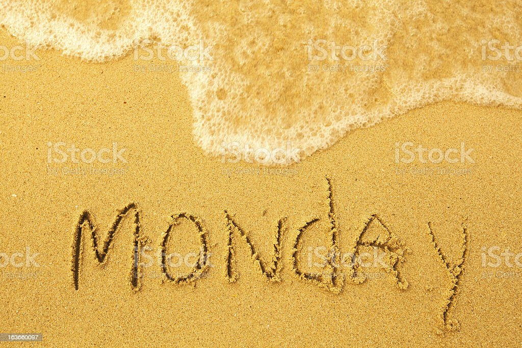 Monday - written in sand on beach texture royalty-free stock photo