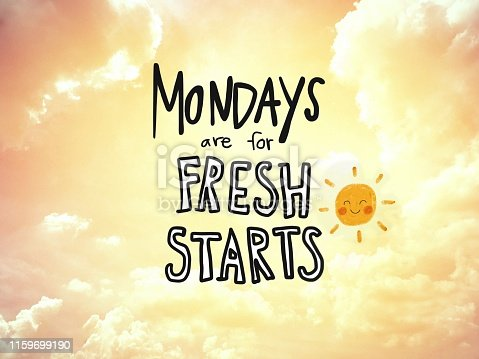 istock Mondays are for fresh starts word lettering and sun smile on golden sky background 1159699190