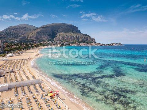 Aerial view of Mondello Beach located near Palermo, Sicily.  Many umbrellas on the beach.