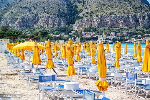 Photo of Mondello Beach located near Palermo, Sicily. Many beach umbrellas and chairs.