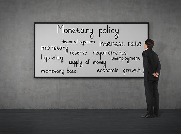monetary policy Businessman think about monetary policy at the blackboard monetary policy stock pictures, royalty-free photos & images