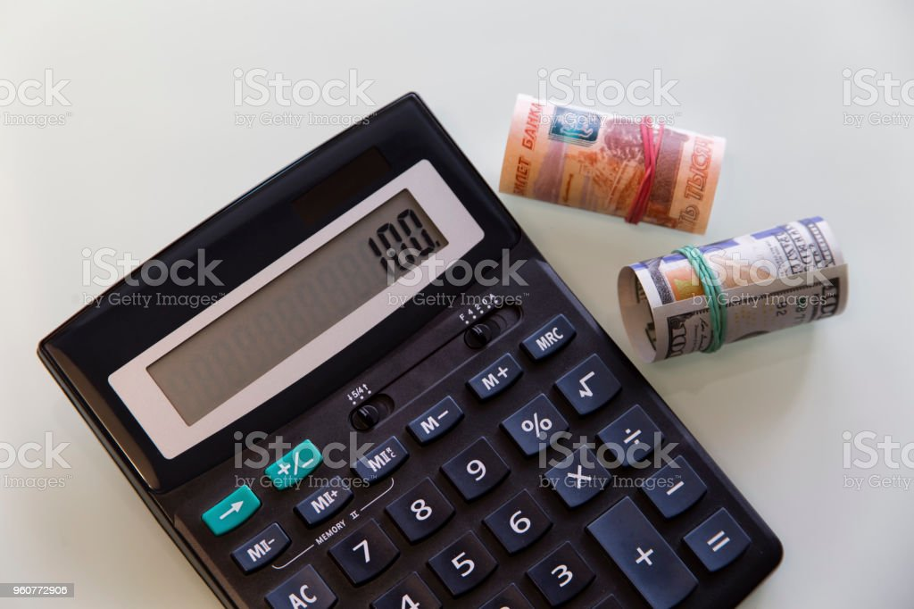 Money american dollar russian ruble and black calculator stock photo