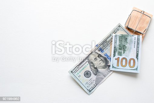848170878istockphoto money american dollars in a mousetrap on a white background with space for text 921984952