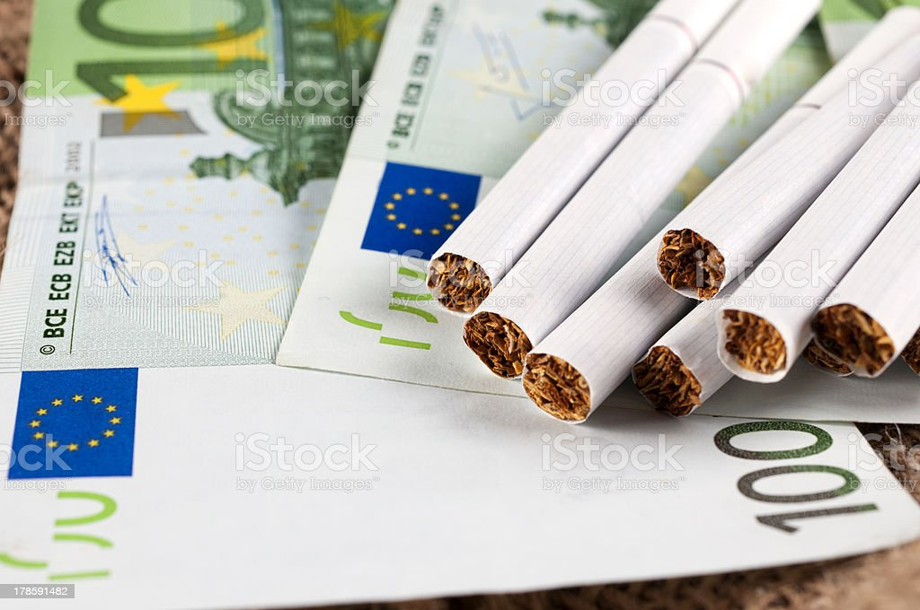 Money and cigarette royalty-free stock photo