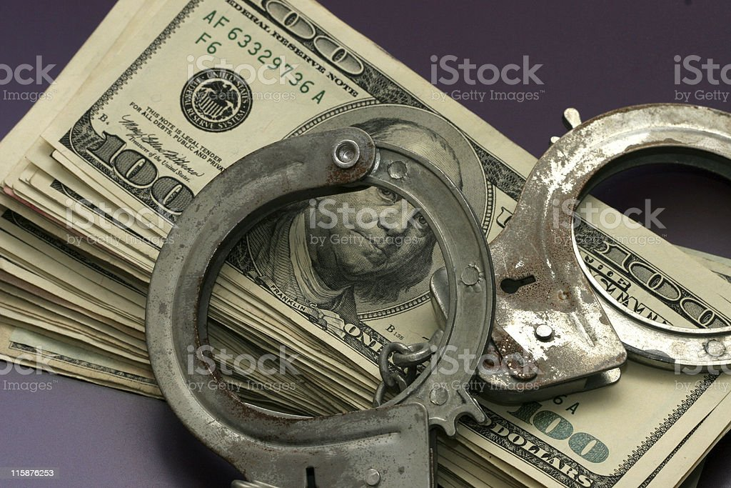 Money and Cuffs royalty-free stock photo