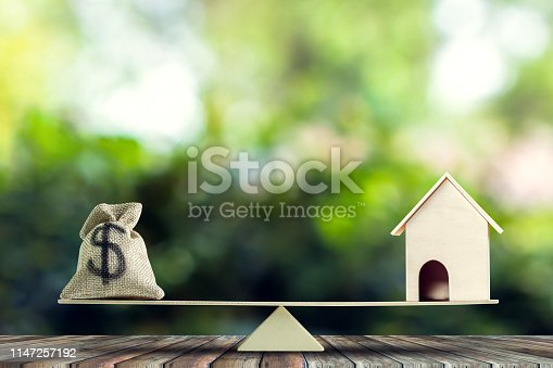 istock Money and home,loan,mortgage. Change home into cash concept. 1147257192