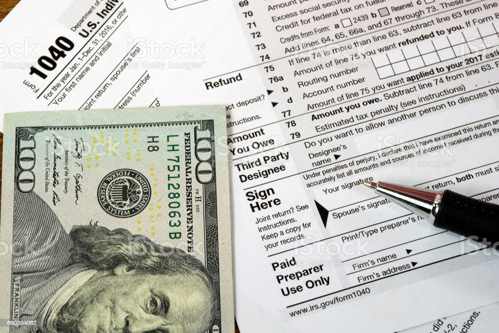 money and ink pen on tax form royalty-free stock photo
