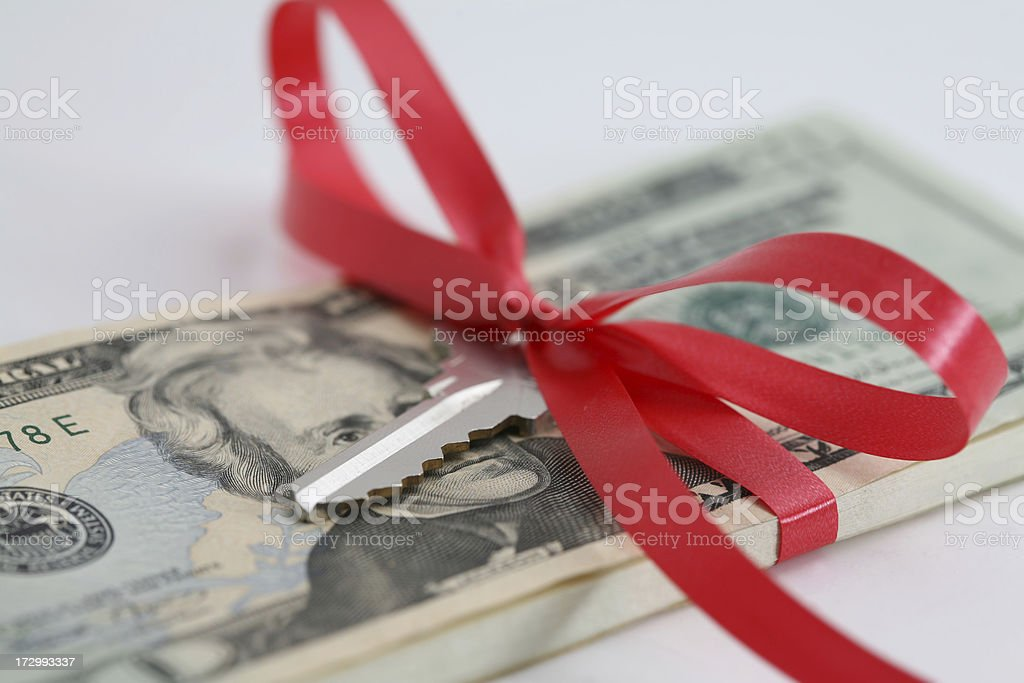 Money and Key Wrapped with Ribbon royalty-free stock photo