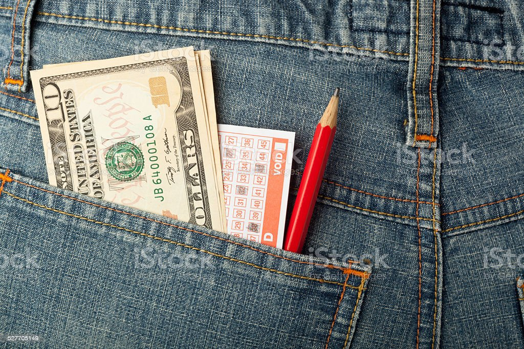 US money and lottery bet slip in pocket stock photo