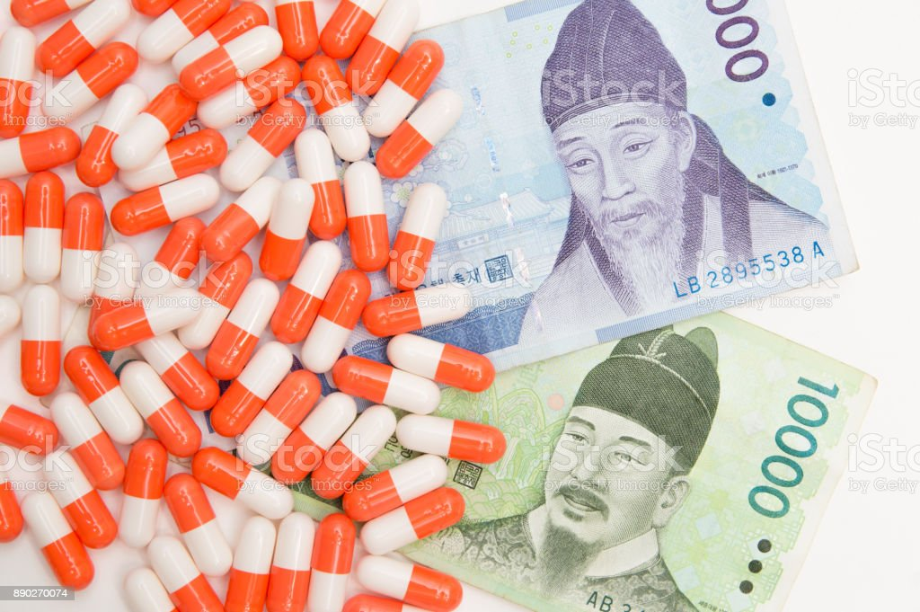money and pill on the white back ground stock photo