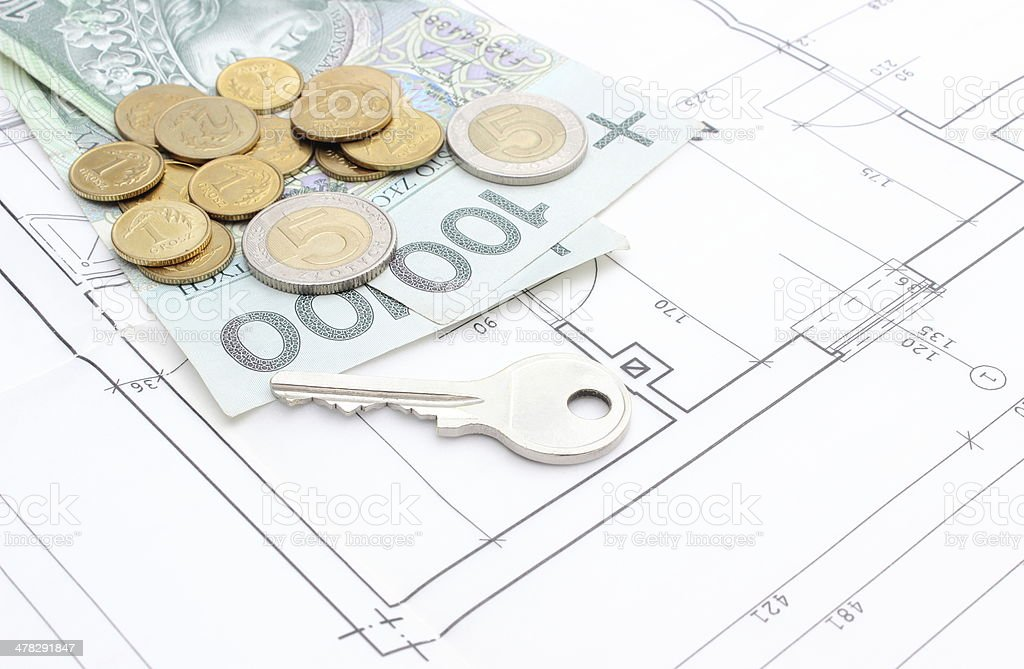 Money and silver key lying on the housing plan royalty-free stock photo