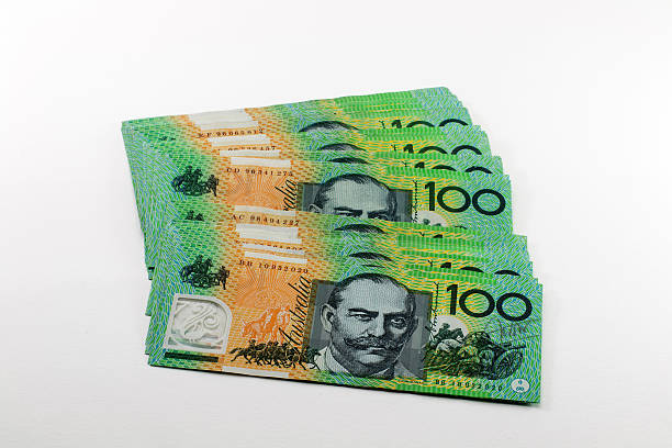 Money Australian hundred dollar bills isolate on white stock photo