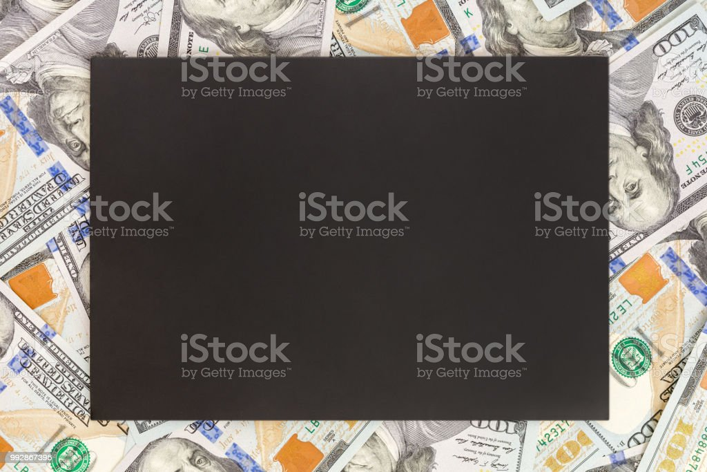 Money background with black mockup. Copyspace dark place for text. US currency one hundred dollar banknotes background. Financial, business and investments concept stock photo