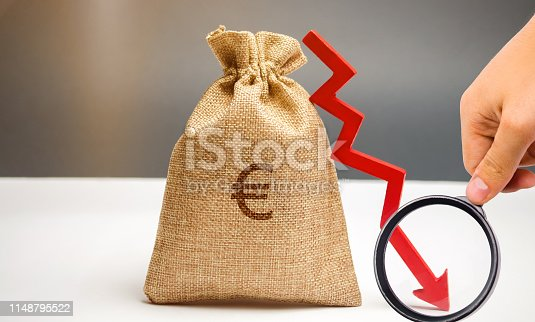 istock Money bag with a euro sign and an arrow down. The concept of reducing profits. Drop in revenue. Low salary. Financial and economic crisis. Recession family budget. Unsuccessful business. 1148795522