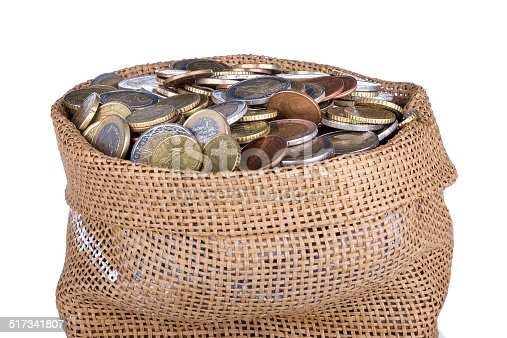 482747823istockphoto Money bag with coins isolated at a white background 517341807