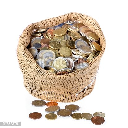 482747823istockphoto Money bag with coins isolated over white 517323781