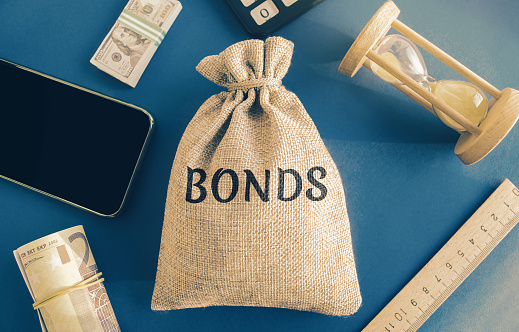 Money bag with the word Bonds. A bond is a security that indicates that the investor has provided a loan to the issuer. Equivalent loan. Unsecured and secured bonds.