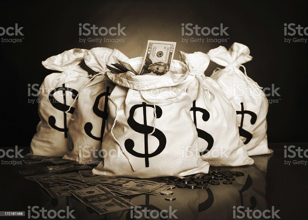 Money bags Money bags in sepia and grain. http://www.lisegagne.com/images/business.jpg Abundance Stock Photo