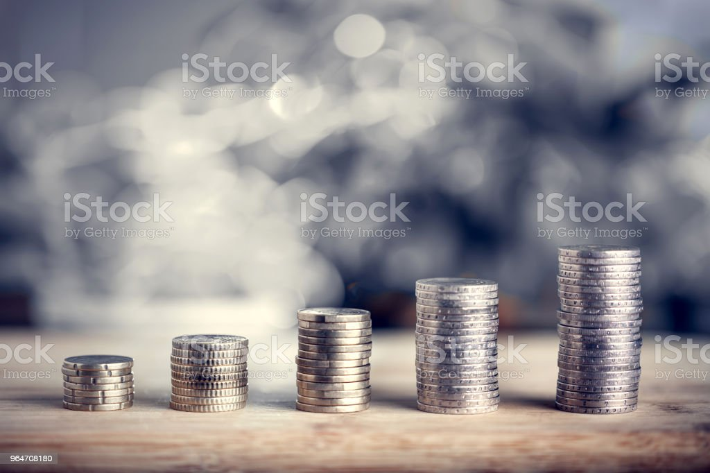 Money bars as financial growth. Euro coins arranged in piles. Banking, finances, taxes, financial operations. royalty-free stock photo