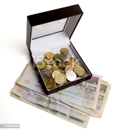 Some coins in a box on top of the bills. Contains clipping path isolation.