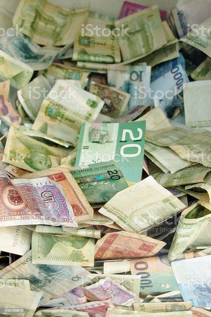 Money Box - Stack of Bills stock photo