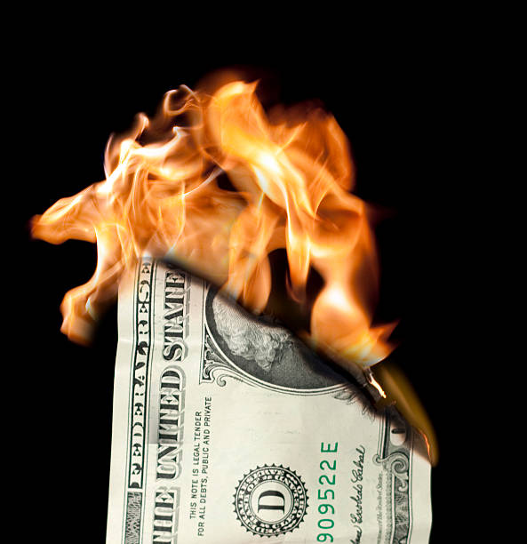 Money Burning One dollar bill burning. money to burn stock pictures, royalty-free photos & images