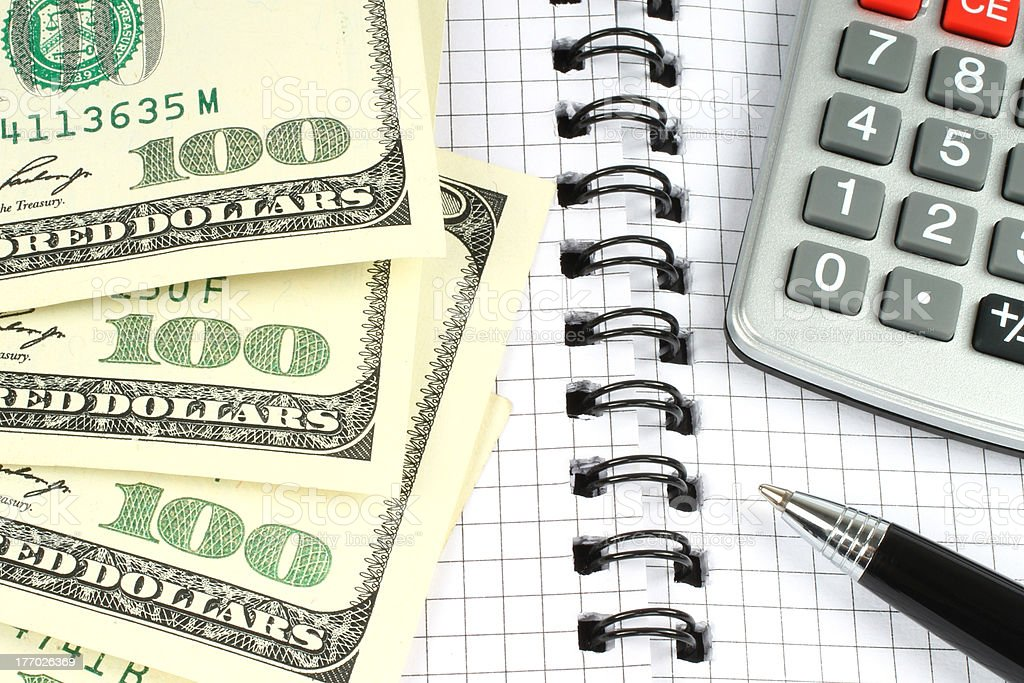 Money, calculator, and pen royalty-free stock photo
