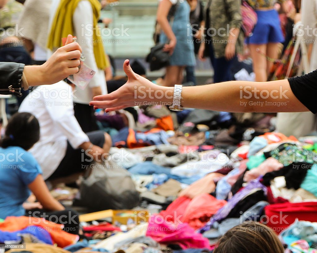 Money Changing Hands at a flea market stock photo