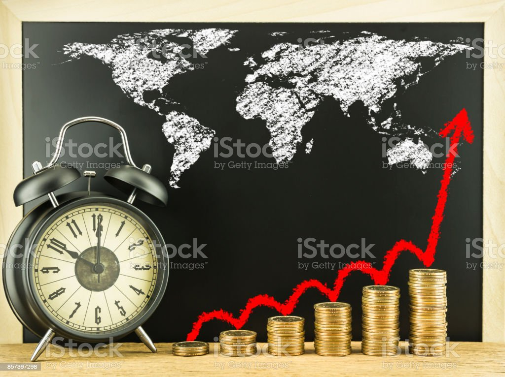 Money coin stack arranged as a graph on wood and black alarm clock money coin stack arranged as a graph on wood and black alarm clock with write red gumiabroncs Images