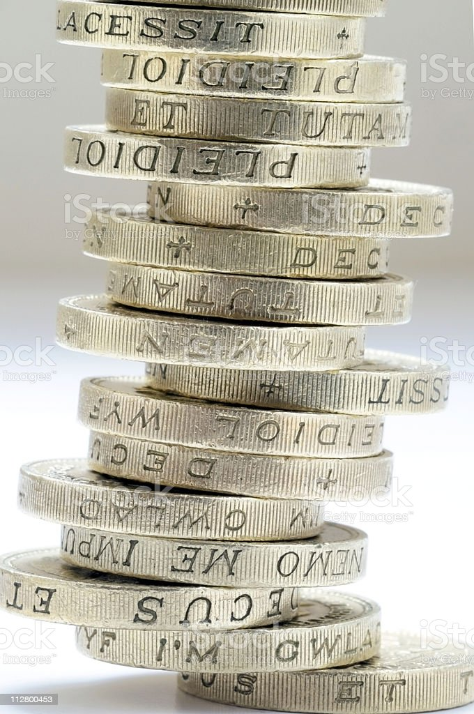 Money coins of 1 pound sterling royalty-free stock photo