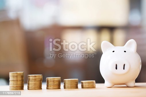 istock money coins stacked on each other in different positions on the wooden table. Credit financial growing business concept. Saving money. Leave space to write descriptive text. 1176597215