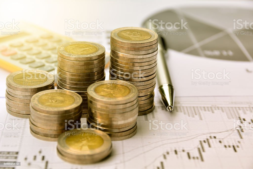 money coins with graph paper and calculator, finance and  business stock photo