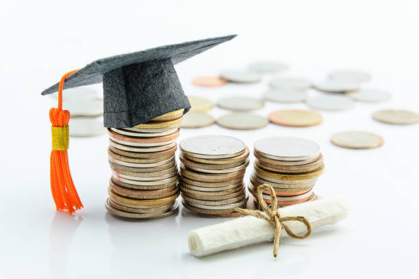 money cost saving or money reserve for goal and success in school, higher level education concept : us dollar coins / cash, a black graduation cap or hat, a certificate / diploma on white background. - charity and relief work stock pictures, royalty-free photos & images