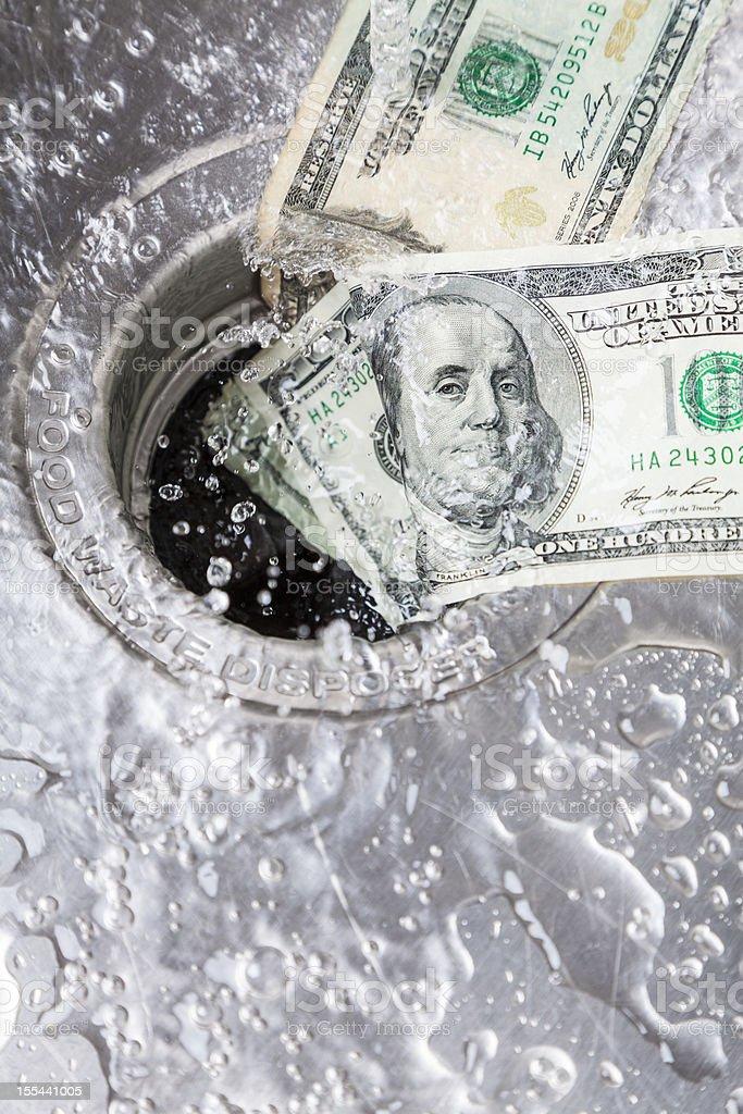 Money Down Drain stock photo