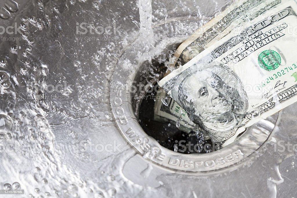 Money Down Drain-englische Redewendung – Foto