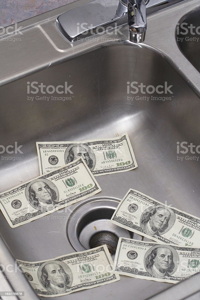 Money down the drain 2 stock photo