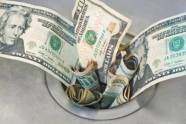 money down the drain - spending money stock pictures, royalty-free photos & images