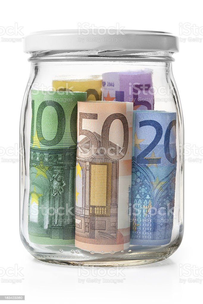 Money. Euro banknotes in a glass jar. stock photo