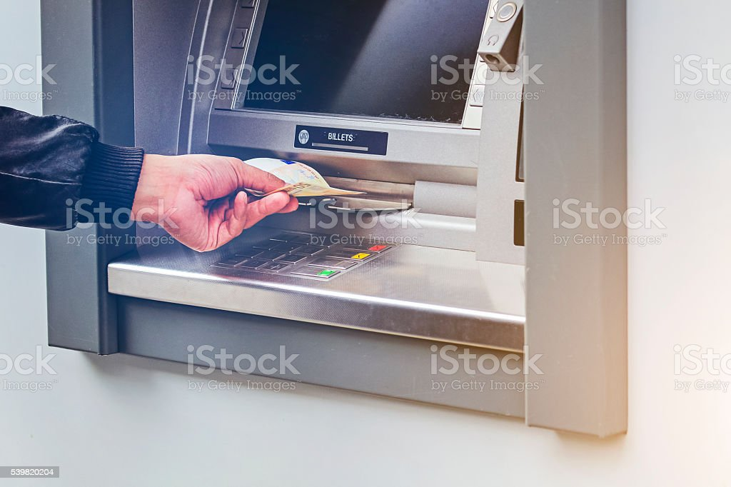 Money euro cash withdrawal from an ATM stock photo