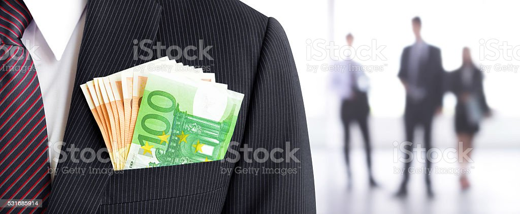 Money, Euro currency (EUR) banknotes, in businessman suit pocket stock photo