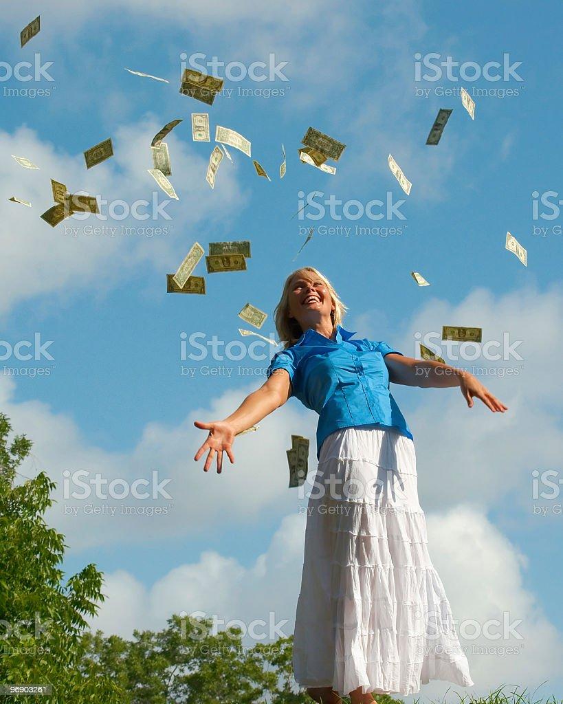 Money Falling From Heaven Blue Sky on Beautiful Woman royalty-free stock photo