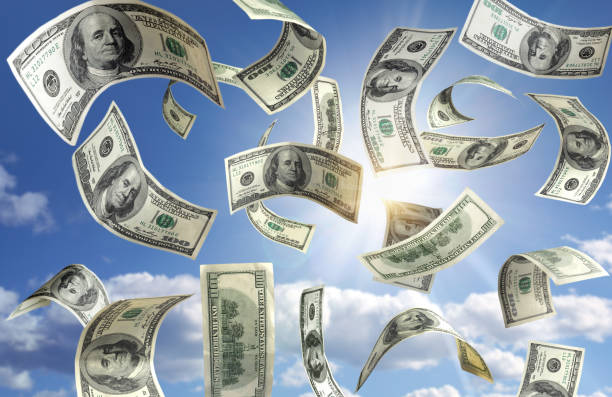 Money falling from the sky Money falling from the sky lottery stock pictures, royalty-free photos & images