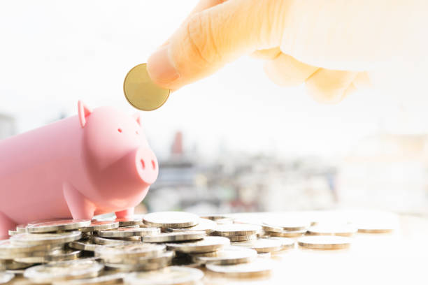Money, Financial, Business Growth concept. Man's hand put money coins to piggy bank. 40 kilometre stock pictures, royalty-free photos & images