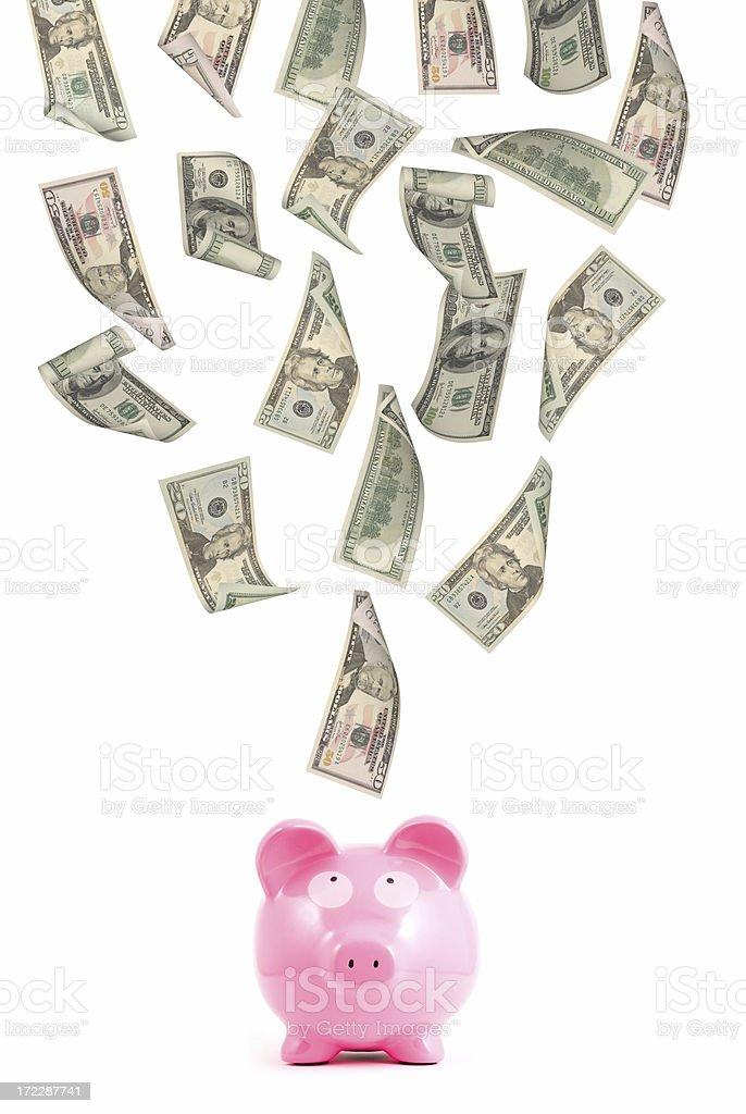 Money floating above piggy bank stock photo