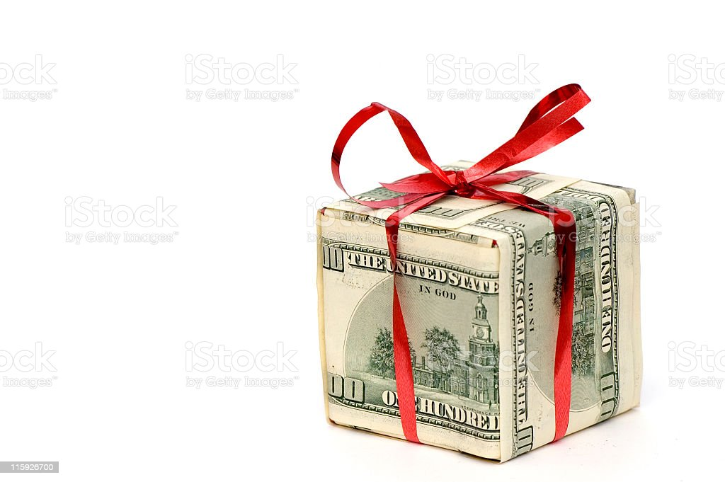 Money folded into a box and tied with a red ribbon royalty-free stock photo