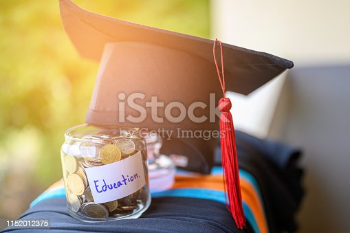 Money for education placed in a glass jar
